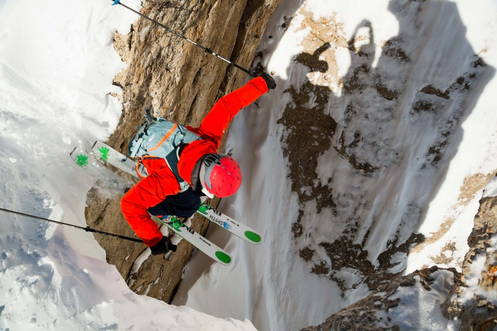 Assess the Risk | Skier dropping into S&S Couloir by Jay Goodrich