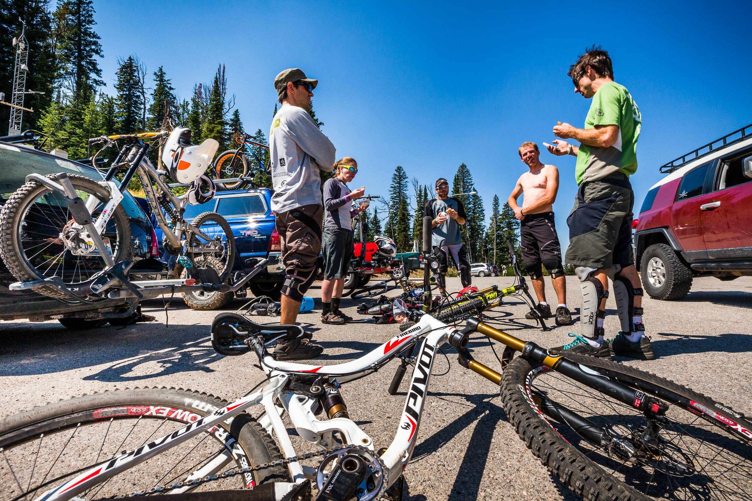 A group of downhill mountain bike riders plan their next assualt off Teton Pass