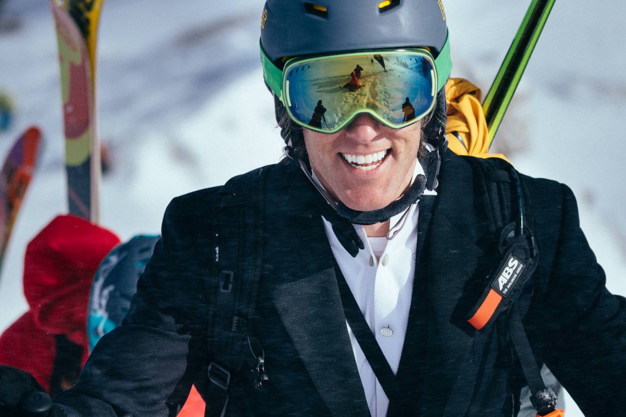 Jeff Annetts hikes towards the top of Powder 8 Face dressed to impress in his tuxedo in You Open Em I Close Em