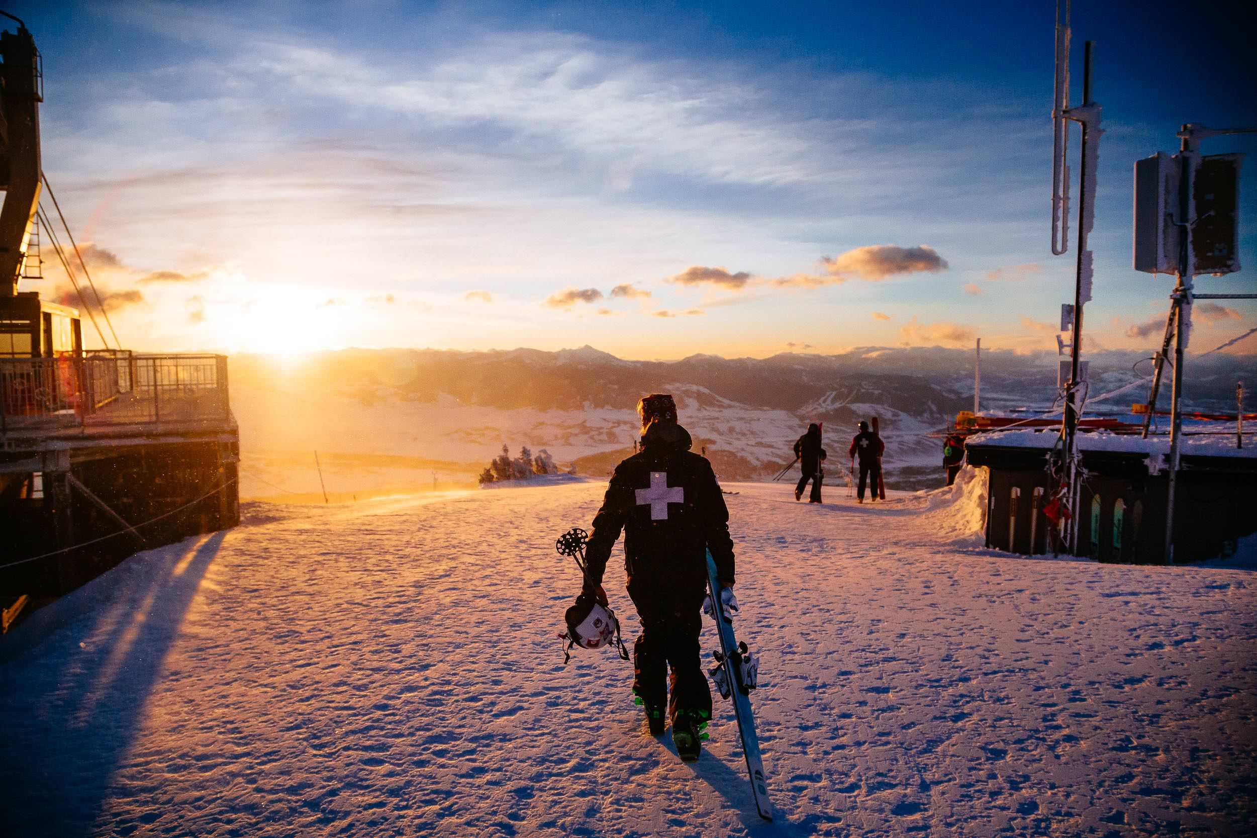 Jen Calder exits the patrol tram at sunrise at Jackson Hole Mountain Resort