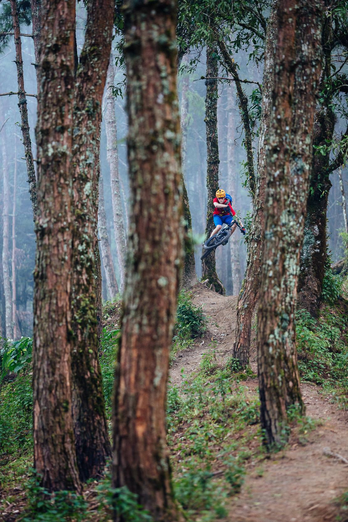 Andrew Whiteford rides the Doi Bakia Trail in the higher altitude jungle near Ban Sop Gai, Thailand