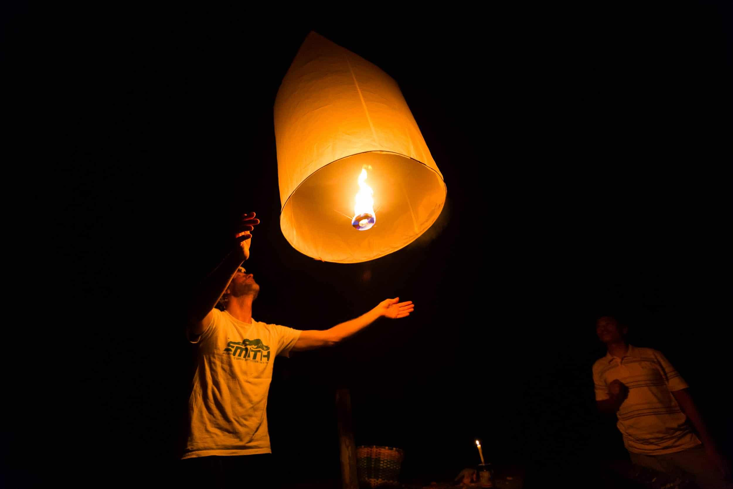 Andrew Whiteford Jay Goodrich release lanterns in a local tribe member's house in the higher altitude jungle near Ban Sop Gai, Thailand