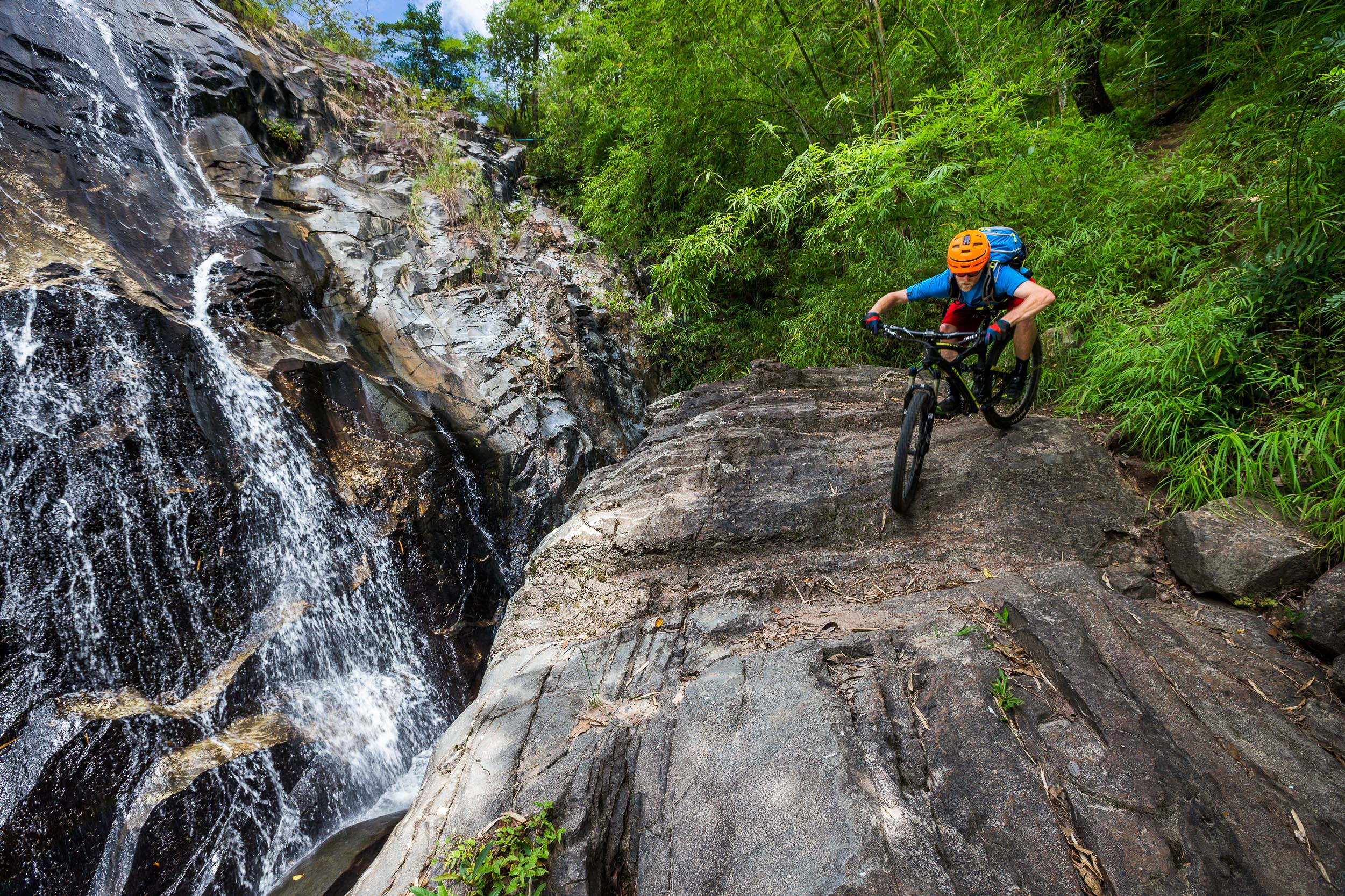 Andrew Whiteford rides the Mae Wang single track trail in the jungle near Chiang Mai, Thailand