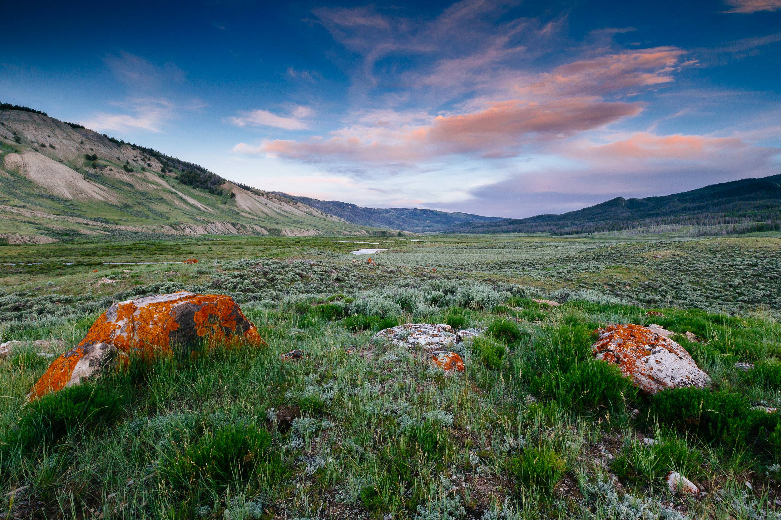 The sun sets over a valley in the Upper Gros Ventre range photo taken for Trust for Public Land