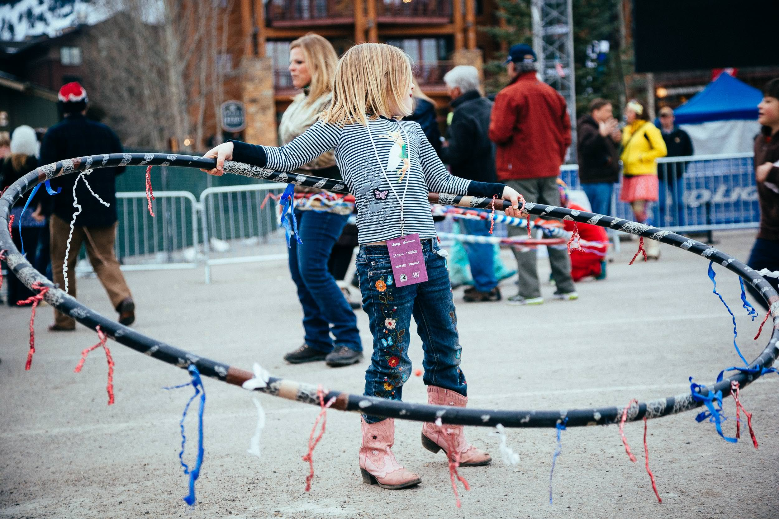 Girls play with hula hoops before the Michael Franti Concert