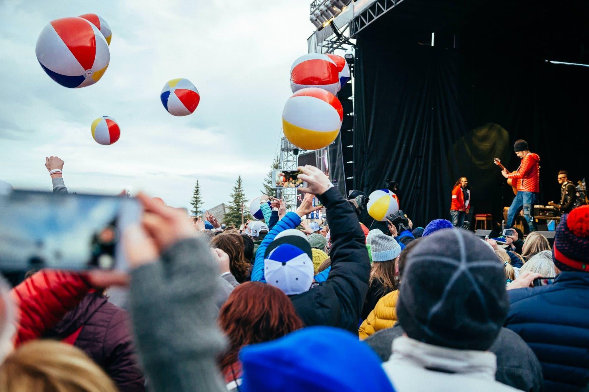 Beach balls bouncing througout the crowd at Michael Franti concert
