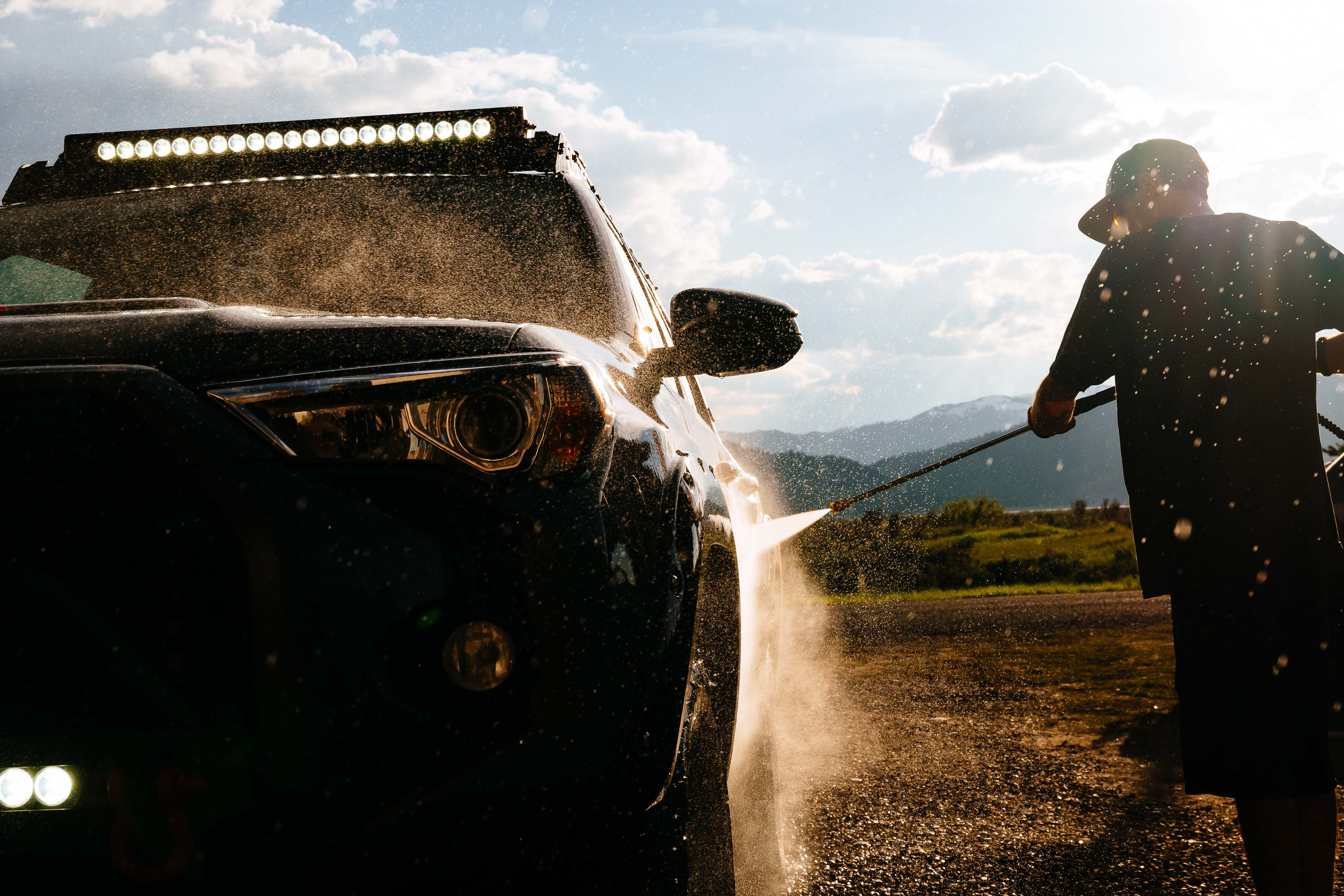 Pressure washing the truck at sunset - Portfolio Photo - By Jay Goodrich